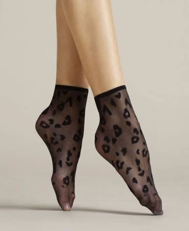 <p>Patterned, transparent socks with a non-pressure band and invisibly reinforced toe portion. Available in 3 colour versions - black, poudre and white.</p>